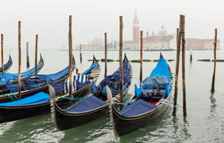 Gondola moored at dock in Venice. Royalty Free Stock Images