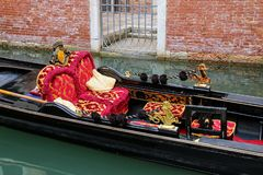Gondola moored in narrow canal in Venice, Italy. Venice is situated across a group of 117 small islands that are separated by canals and linked by bridges royalty free stock photos