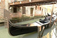 Gondola moored under bridge Royalty Free Stock Photos