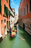 Gondola in the morning. Many gondolas standing and slowly moving in a canal during a water traffic jam in the morning, Venice, Italy Royalty Free Stock Image
