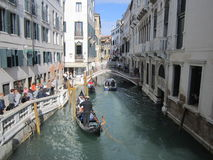 Gondola. And motorboat moving along the canals of Venice Royalty Free Stock Photo