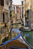 Gondola moving through one of many canals of Venice Stock Images