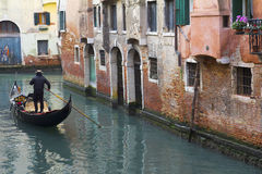 Gondola in a narrow canal Royalty Free Stock Photography