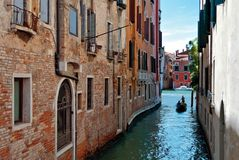Gondola on a narrow canal Royalty Free Stock Photo
