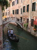 Gondola on narrow canal Royalty Free Stock Image