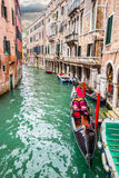 Gondola in a narrow canal Royalty Free Stock Images
