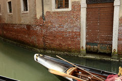 Gondola in narrow canal Stock Images