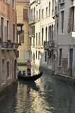 Gondola by a narrow canal Stock Photography