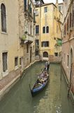 Gondola in narrow canal Royalty Free Stock Photos
