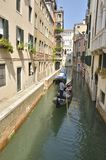 Gondola in a narrow canal Stock Photos