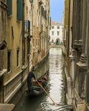 Gondola in narrow canal, Venice Stock Photo