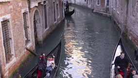 Gondola in narrow canals of Venice stock video footage