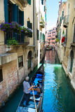 Gondola at narrow Venice canal Stock Photography