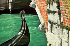 Gondola and old bridge in Venice, Italy. Royalty Free Stock Photos