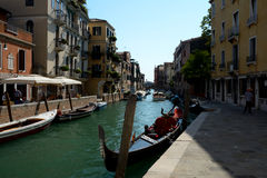Gondola and other boats on canal in Venice, Italy Royalty Free Stock Photography