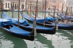 Gondola park Venive. Gondolas parked in a row on canal, Venice, Veneto region, Italy Royalty Free Stock Photography