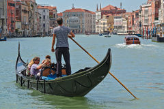 Gondola with passengers in Grand Canal. Venice, Italy Stock Image