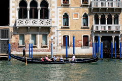 Gondola with passengers in Grand Canal. Venice, Italy Royalty Free Stock Photos