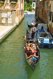 Gondola with passengers in Venice Royalty Free Stock Photo