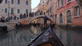 Gondola Passing under the Bridge. Venice Italy 29 Oct 2016: Gondola Passing under the Bridge. Venice gondola travel. Venice gondolas. Venice 4K. Venice tour stock video footage