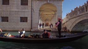 Gondola Passing under the Bridge. Venice Italy 29 Oct 2016: Gondola Passing under the Bridge. Venice gondola travel. Venice gondolas. Venice 4K. Venice tour stock footage