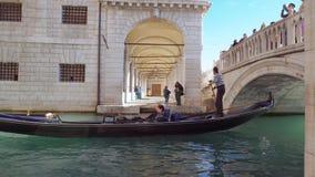 Gondola Passing under the Bridge. Venice Italy 29 Oct 2016: Gondola Passing under the Bridge. Venice gondola travel. Venice gondolas. Venice 4K. Venice tour stock video