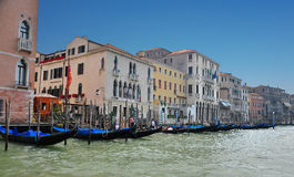Gondola picking-up on the canal. A shot of a gondolas tied in front of buildings in venice italy Stock Photos