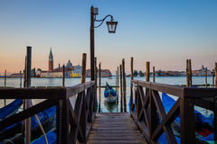 Gondola at pier at sunrise, Venice, Italy Stock Images