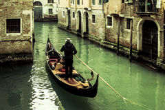 Gondola on quiet Venice canal royalty free stock images