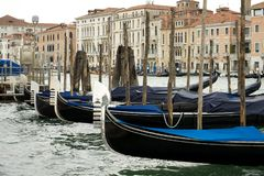 Gondola rank in Venice. Gondolas lined up on the Grand Canal such an iconic and instantly recognisable Venice attraction. Taken in July 2014 Stock Photo