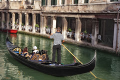 Gondola and restaurant in Venice Royalty Free Stock Image