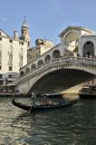 Gondola at the Rialto bridge Stock Images