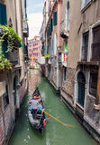 Gondola sailing tourists in Venice Royalty Free Stock Image