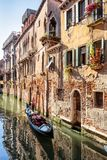 Gondola sails along old street with vintage houses in Venice, It Stock Photos