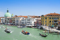 Gondola sails down the channel in Venice Stock Image