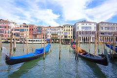 Gondola sails down the channel in Venice Stock Images