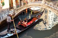Gondola sails on the old beautiful street in Venice. Venice, Italy - May 21, 2017: Gondola sails on the old beautiful street in Venice. Gondola is the most royalty free stock image