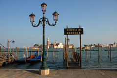 Gondola service in Venice. Gondola moorings in front of San Giorgio Maggiore Stock Image