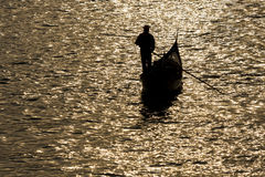 Gondola silhouette on venetian canal at evening Stock Photos