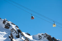 Gondola ski lift in high mountains Stock Images