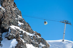 Gondola ski lift in high mountains Stock Photos