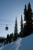 Gondola at ski resort, backlit trees Royalty Free Stock Photos