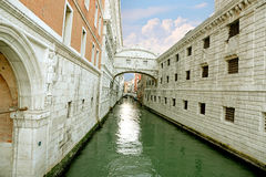 Gondola on small canal passing towards famous Bridge of Sighs (Ponte dei Sospiri) in Venice, Italy Royalty Free Stock Photo