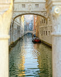 Gondola on small canal passing towards famous Bridge of Sighs (Ponte dei Sospiri) in Venice, Italy Stock Image