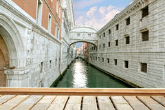 Gondola on small canal passing towards famous Bridge of Sighs Ponte dei Sospiri in Venice, Italy Royalty Free Stock Image