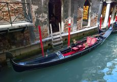 Gondola on small canal. Traditional venetian gondola on small canal in Venice, Italy Stock Photo