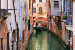 Gondola on small canal in Venice, Italy. Royalty Free Stock Photo
