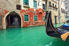 Gondola on small canal in Venice, Italy. Stock Photography