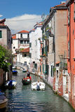 The gondola on a small Venetian canal Stock Image