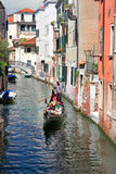 The gondola on a small Venetian canal Royalty Free Stock Photo